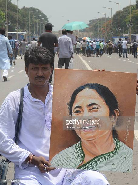 TMC supporter showing portrait of West Bengal Chief Minister Mamata Banerjee during her oath taking ceremony on May 27 2016 in Kolkata India The...