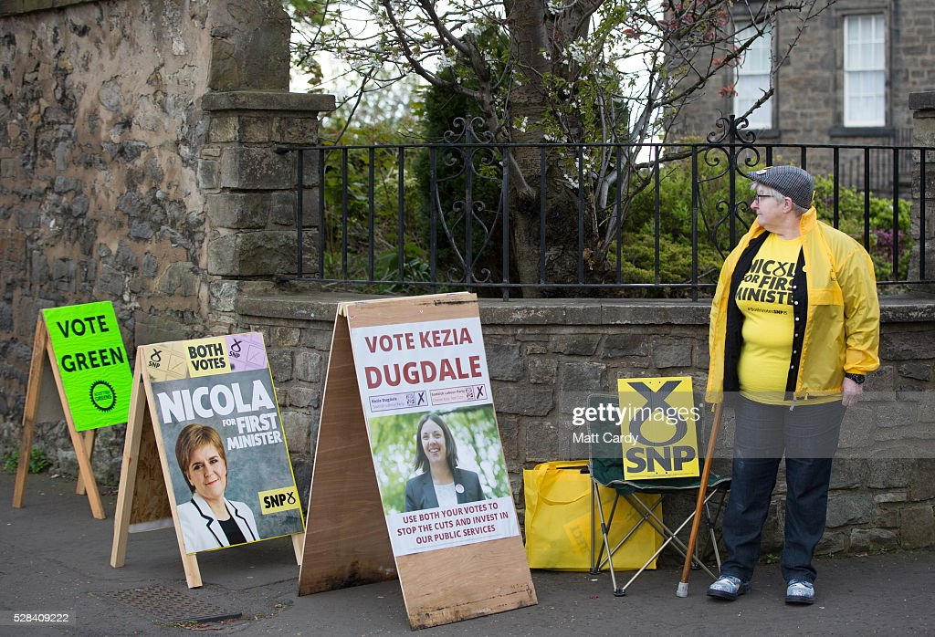 A SNP supporter stands outside St Ninian & Triduana RC Church as people vote in the Scottish Parliament elections on May 5, 2016 in Edinburgh, Scotland. Today, dubbed 'Super Thursday', sees the British public vote in countrywide elections to choose members for the Scottish Parliament, the Welsh Assembly, the Northern Ireland Assembly, Local Councils, a new London Mayor and Police and Crime Commissioners. There are around 45 million registered voters in the UK and polling stations open from 7am until 10pm.