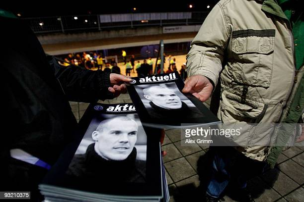 A supporter takes a booklet with a picture of German goalkeeper Robert Enke before the International friendly match between Germany and the Ivory...