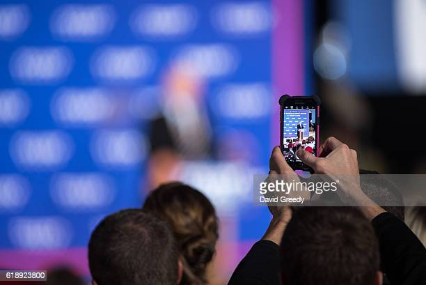 A supporter takes a photograph of Republican Presidential candidate Donald J Trump during a rally at the McGrath Amphitheater on October 28 2016 in...