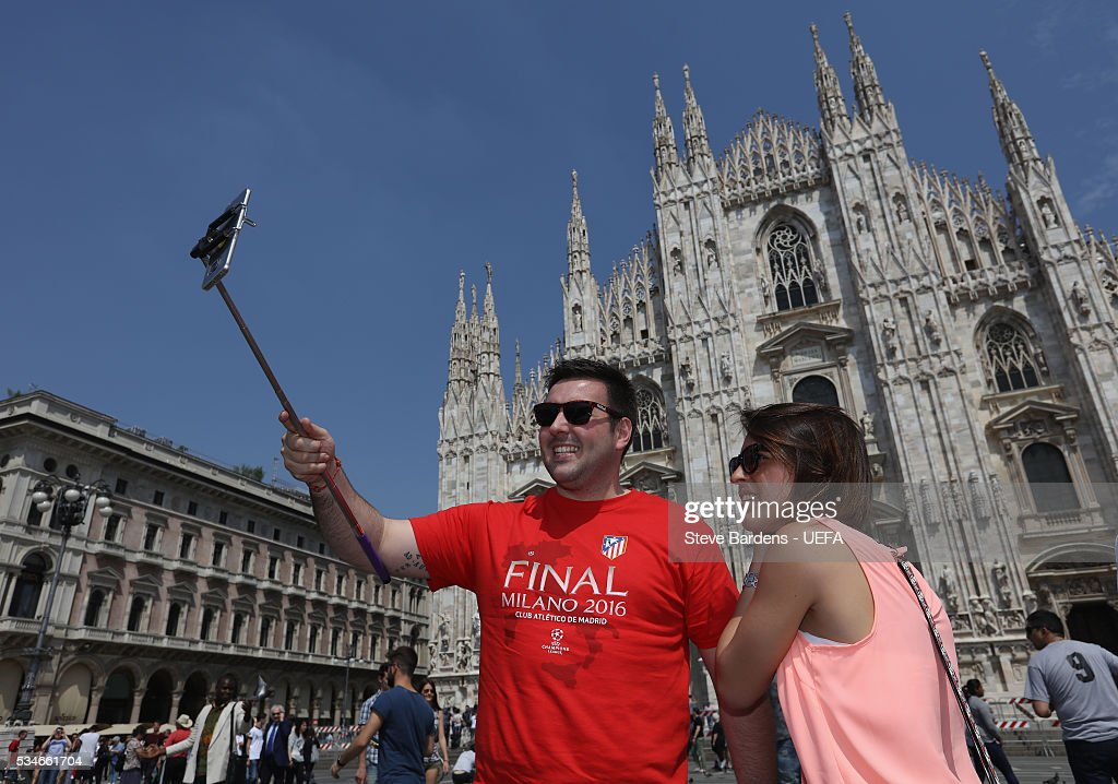 A supporter takes a selfie during the Fans Festival outside the Duomo in the centre of Milan prior to the UEFA Champions League Final between Real Madrid and Atletico Madrid on May 27, 2016 in Milan, Italy.