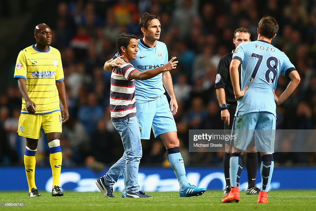 A supporter takes a 'selfie' of Frank Lampard of Manchester City during the Capital One Cup Third Round match between Manchester City and Sheffield...