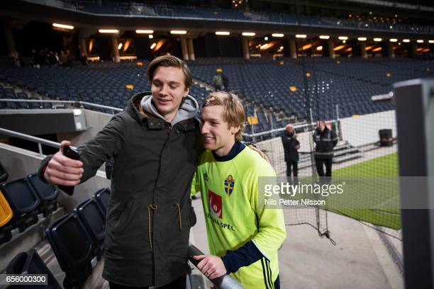 A supporter takes a selfie with Emil Forsberg of Sweden during Sweden National Team training session at Friends arena on March 21 2017 in Solna Sweden