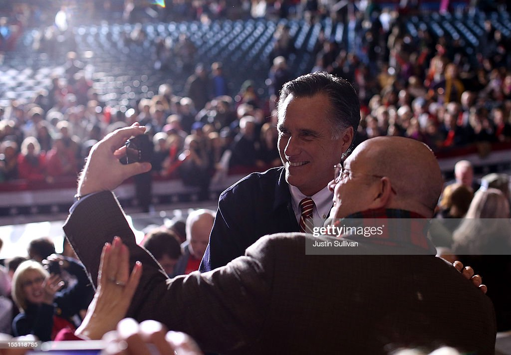 A supporter takes his picture with Republican presidential candidate, former Massachusetts Gov. Mitt Romney during a campaign event at Farm Bureau Live on November 1, 2012 in Virginia Beach, Virginia. With less than one week to go until election day, Mitt Romney is campaigning in Virginia.