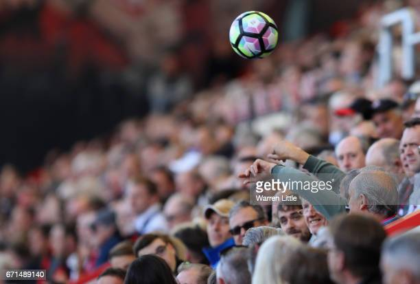 A supporter throws the match ball back onto the pitch during the Premier League match between AFC Bournemouth and Middlesbrough at the Vitality...