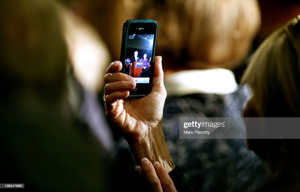 A supporter uses her iPhone to record Republican presidential candidate, former Speaker of the House Newt Gingrich speak during a campaign rally at the Marriott Denver West February 6, 2012 in Golden, Colorado. Gingrich is visiting Colorado to meet supporters and share his solutions for creating jobs, balancing the budget and paying down our national debt in advance of Tuesday's Republican Caucuses in the state.