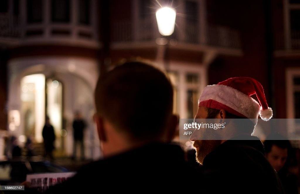 A supporter waits ahead of Wikileaks founder Julian Assange speech to members of the media and supporters from the window of the Ecuadorian embassy in Knightsbridge, west London on December 20, 2012 WikiLeaks founder Julian Assange marked six months holed up in Ecuador's embassy in London on December 19, 2012, with no end in sight to a diplomatic stand-off that has even dragged in pop icon Lady Gaga. AFP PHOTO/Leon Neal