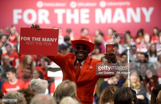 A supporter waits for Jeremy Corbyn shadow chancellor John McDonnell shadow business secretary Rebecca LongBailey and Eastenders actress Maddy Hill...