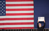 A supporter waits for Republican presidential candidate Donald Trump to arrive at a rally at Macomb Community College on March 4 2016 in Warren...