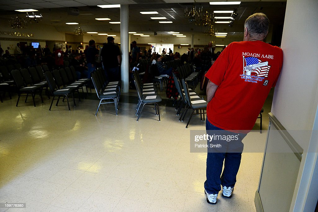 A supporter waits for speakers to arrive during the Delaware State Sportsmen's Association Second Amendment rally at the Modern Maturity Center on January 20, 2013 in Dover, Delaware. U.S. President Barack Obama recently unveiled a package of gun control proposals that include universal background checks and bans on assault weapons and high-capacity magazines.