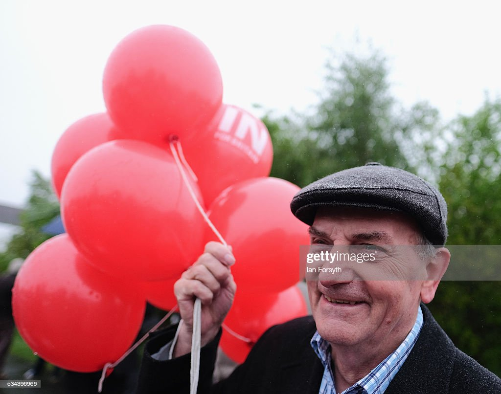 A supporter waits with balloons for Shadow Foreign Secretary Hilary Benn MP as he visits the Angel of the North with the Labour In for Britain battle bus on May 26, 2016 in Gateshead, England. The 'Labour In' battle bus will make several trips to the north east region to encourage the British public to vote to remain in the EU in the June 23rd referendum.