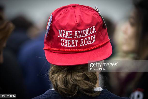 A supporter wearing a hat with the Trump campaign slogan Make America great again' waits for the start of a campaign rally for US Republican...