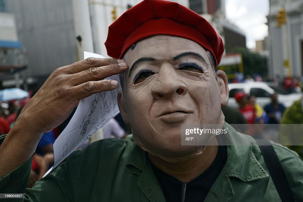 A supporter wearing a mask depicting Venezuelan President Hugo Chavez is seen outside the National Assembly in Caracas on January 5, 2013. Venezuelan lawmakers gathered Saturday for a key leadership vote and debate as President Hugo Chavez's battle with cancer appeared almost certain to delay his swearing-in for a new six year term.AFP PHOTO/Leo Ramirez