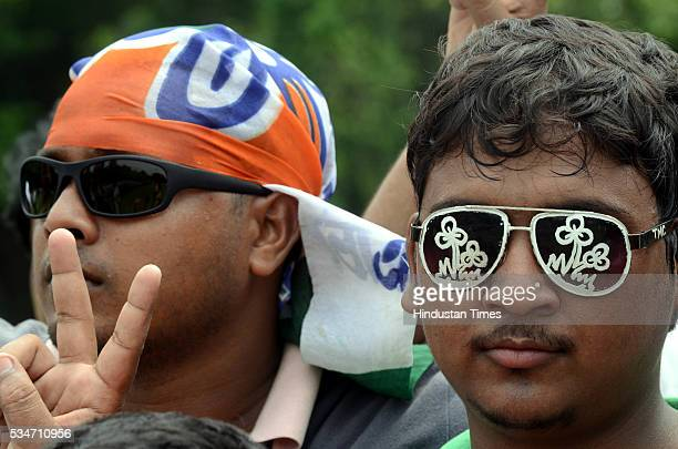 TMC supporter wearing glasses with party symbol drawn on lenses during the oath taking ceremony of West Bengal Chief Minister Mamata Banerjee on May...