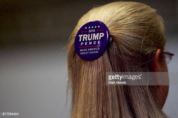 A supporter wears a campaign pin in her hair before Republican Presidential nominee Donald J Trump holds an event at the Eisenhower Hotel and...