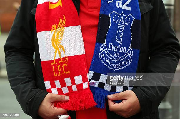A supporter wears a friendship of Liverpool and Everton priorto the Barclays Premier League match between Liverpool and Everton at Anfield on...