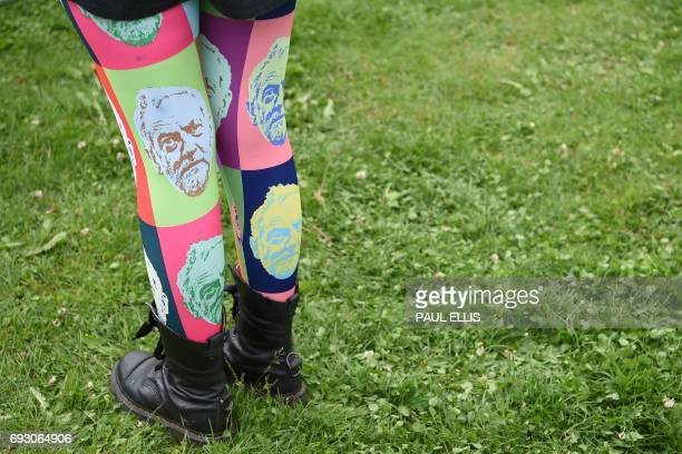 A supporter wears a pair of Jeremy Corbyn decorated tights at a general election campaign event in Birmingham central England on June 6 2017 Britain...