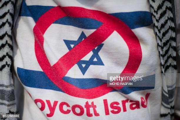 A supporter wears a Tshirt reading 'Boycott Israel' at the Palestinian embassy in Kuala Lumpur during a rally against Israeli air strikes on Gaza on...