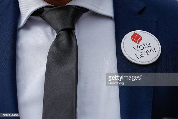 A supporter wears a Vote Leave badge at a rally during the first day of a nationwide bus tour to campaign for a socalled Brexit in Exeter UK on...