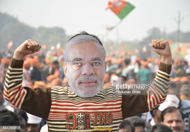 BJP supporter wears Modi mask during an election campaign rally of Prime Minister Narendra Modi on February 8 2017 in Ghaziabad India Prime Minister...