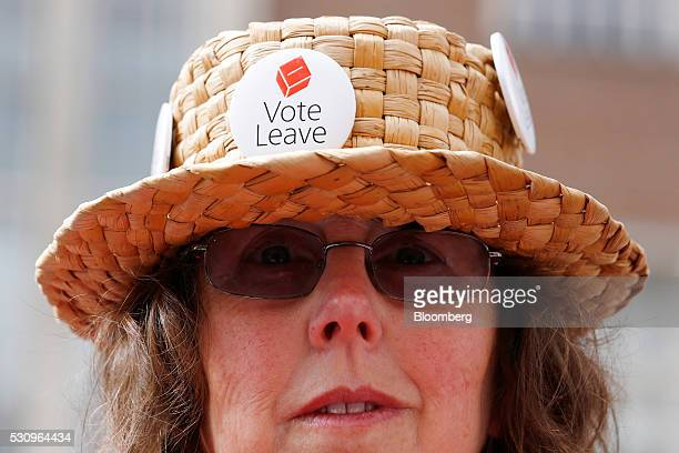 A supporter wears Vote Leave badges at a rally during the first day of a nationwide bus tour to campaign for a socalled Brexit in Exeter UK on...