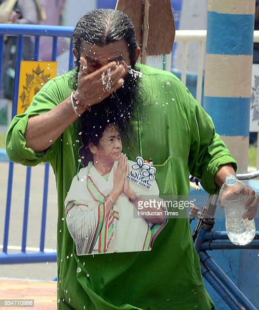 TMC supporter with cutout of West Bengal Chief Minister Mamata Banerjee during her oath taking ceremony on May 27 2016 in Kolkata India The presence...