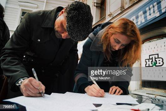 Supporters add their signatures to a petition in support of the independent NTV Russian television channel organized by public organizations April 8...