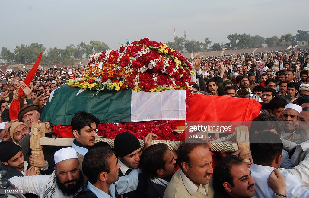 Supporters and activists of Bashir Bilour, the number two to the chief minister of the province, carry his coffin during a funeral ceremony in Peshawar on December 23, 2012. Bilour was killed on December 22 when a suicide bomber stuck when around 100 people including the provincial leadership of the Awami National Party (ANP) had gathered, killing him and eight other people in northwest Pakistan, officials said, in an attack claimed by the Taliban.