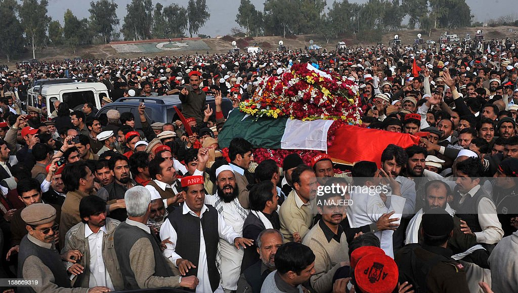 Supporters and activists of Bashir Bilour, the number two to the chief minister of the province, carry his coffin (centre R) during a funeral ceremony in Peshawar on December 23, 2012. Bilour was killed on December 22 when a suicide bomber stuck when around 100 people including the provincial leadership of the Awami National Party (ANP) had gathered, killing him and eight other people in northwest Pakistan, officials said, in an attack claimed by the Taliban.