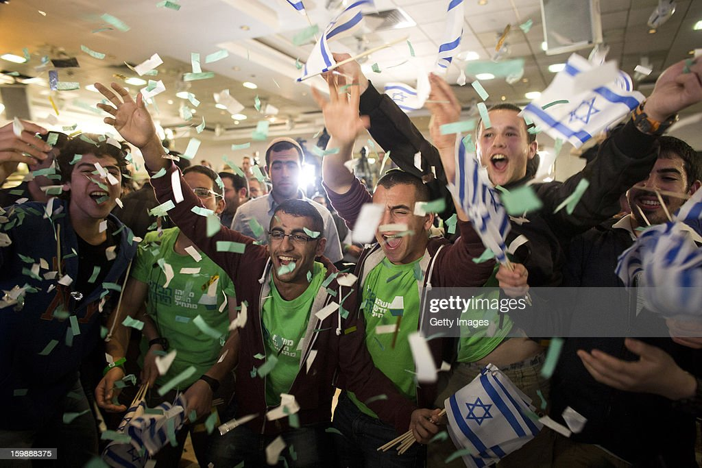Supporters and activists of the Habayit Hayehudi party (The Jewish Home) react to the announcement of the first projections on the results of Israel's national elections at a post-election rally on January 22, 2013 in Ramat Gan, Israel. Polls are predicting 12 seats of 120 in the Israeli parliament for the right-wing, religious party led by Naftali Bennett, with Israel seeing the highest turnout of voters since 1999.
