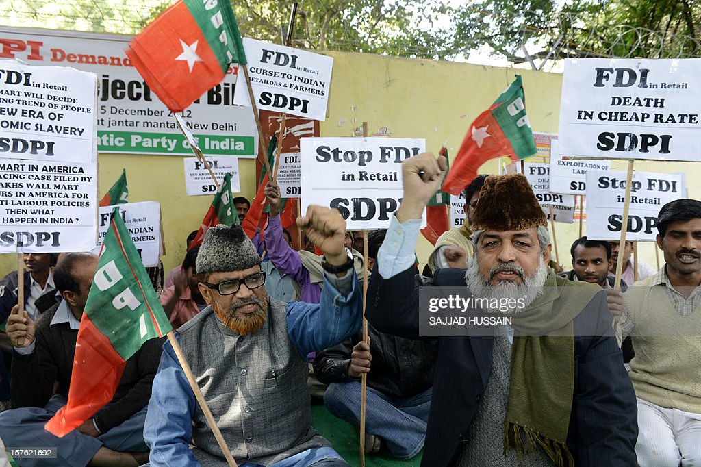 Supporters and activists of the Social Democratic Party of India protest against the Indian Government's decision to allow Foreign Direct investment (FDI) in the retail market during a rally in New Delhi on December 5, 2012. After two days of stormy debating in the rowdy lower house, Indian lawmakers are set to pass judgement on new rules opening up the highly protected retail sector to foreign supermarkets that are being allowed in for the first time.