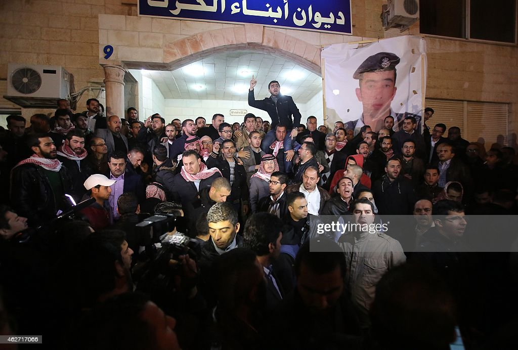 Supporters and family members of Jordanian pilot First Lieutenant Maaz alKassasbeh 26yearold gather following his reported killing at the Karak...