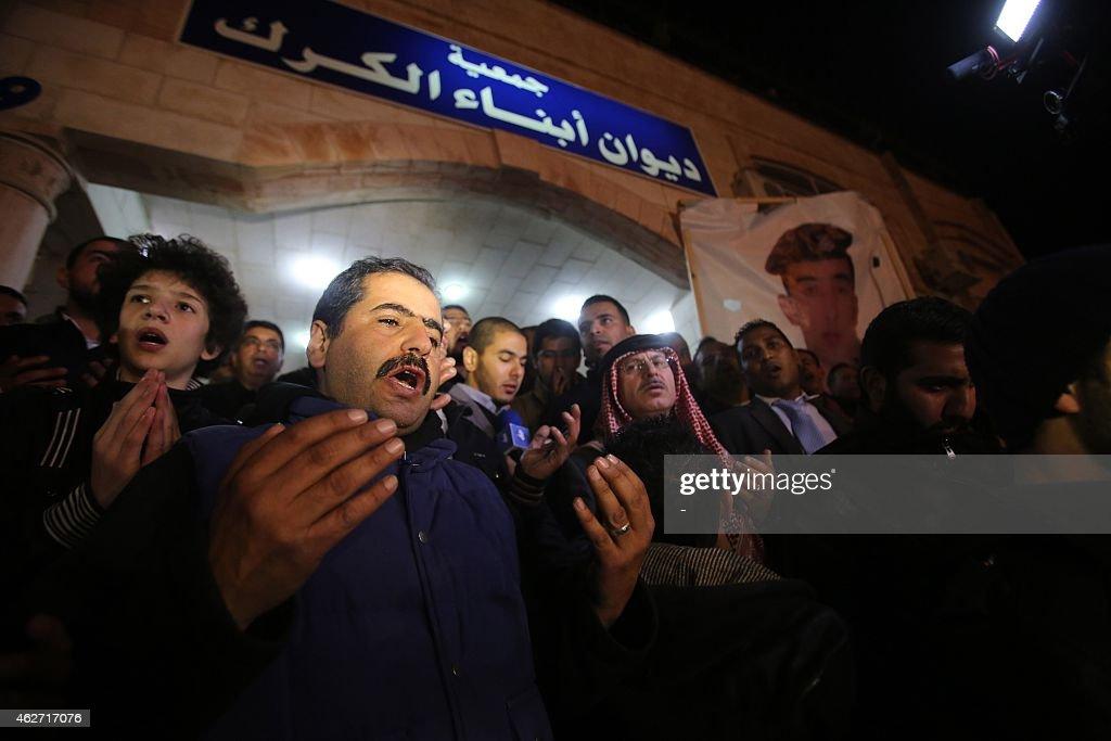 Supporters and family members of Jordanian pilot First Lieutenant Maaz alKassasbeh 26yearold say prayers following his reported killing at the Karak...