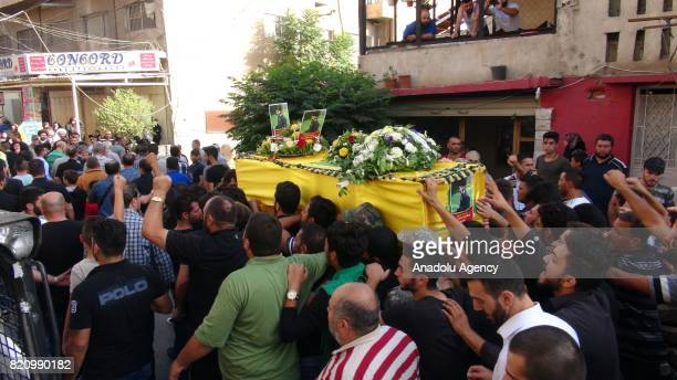 Supporters and members of Hezbollah carry a coffin during the funeral of two of their comrades killed on day two of an Iran backed military operation...