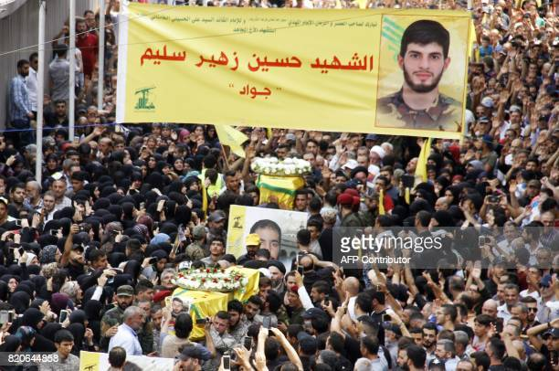 Supporters and members of Lebanon's Shiite Muslim movement Hezbollah attend the funeral of six of their comrades killed during a military operation...
