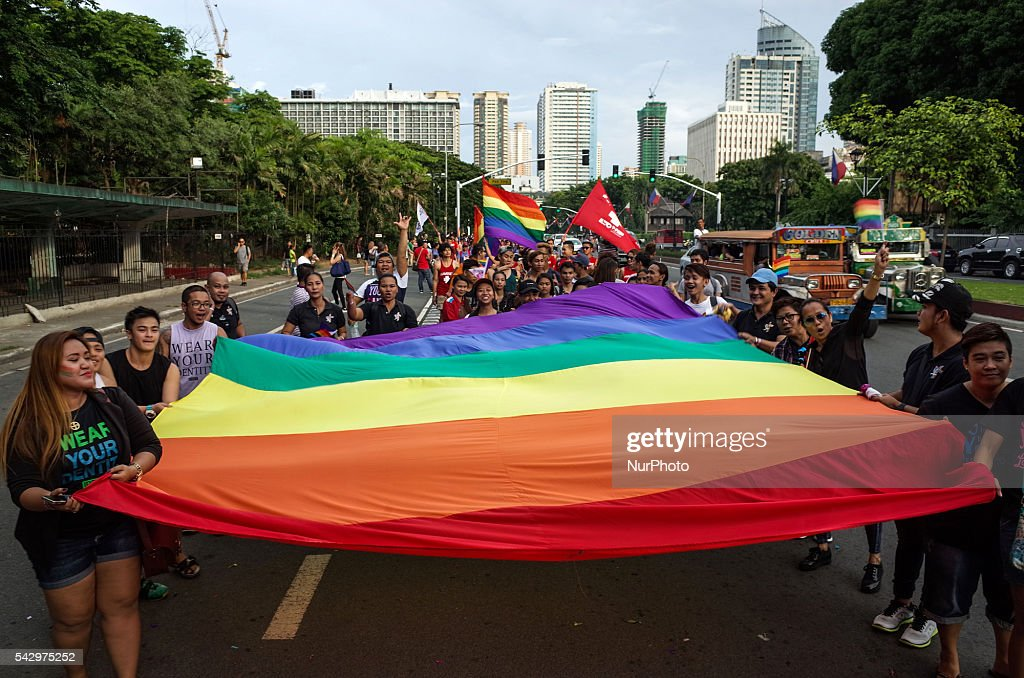Supporters and members of the LGBT community hold a giant rainbow flag during the annual LGBT pride parade at Rizal Park in Manila on Saturday, 25 June 2016. Hundreds of supporters and members of the lesbian, gay, bisexual, and transgender (LGBT) community paraded in Manila calling for the passage of an anti-discrimination law, as well as calling for justice for the shooting in a gay club in Orlando that left 53 people dead.