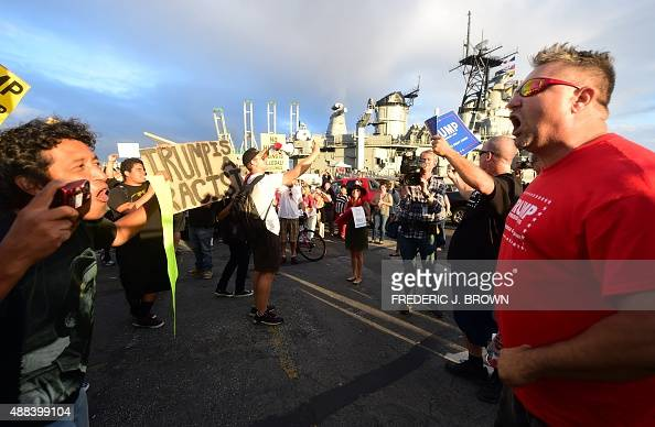 Supporters and protesters argue as Republican Presidential candidate Donald Trump speaks on board the USS Iowa in San Pedro California on September...