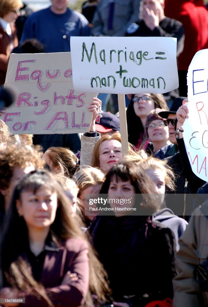 Supporters and protesters hold signs before the start of the same sex weddings at the New Paltz Village Hall February 27 in New Paltz New York Mayor...