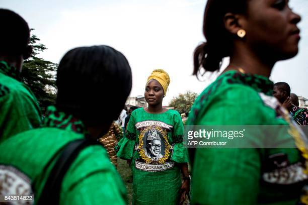 TOPSHOT Supporters and relatives of Mobutu Sese Seko late dictator of Zaire former name of Democratic Republic of the Congo attend a mass marking the...