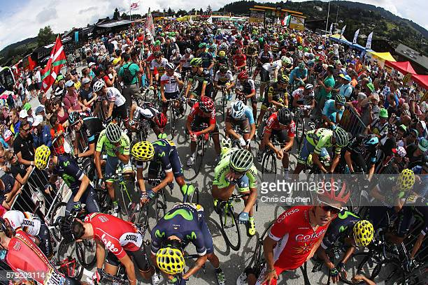 Supporters and the Media watch on as riders prepare to begin stage twenty of the 2016 Le Tour de France from Megeve to Morzine on July 23 2016 in...