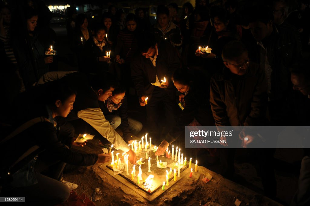 Supporters and Tibetans living in-exile take part in a candle light march in New Delhi on December 10, 2012 to mark World Human Rights Day. A 16-year-old Tibetan girl has died after setting herself on fire, Chinese state media said December 10, in an area that has become a flashpoint for protests against Beijing's rule.