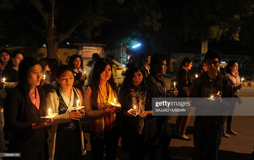 Supporters and Tibetans living in-exile take part in a candle light march in New Delhi on December 10, 2012 to mark World Human Rights Day. A 16-year-old Tibetan girl has died after setting herself on fire, Chinese state media said December 10, in an area that has become a flashpoint for protests against Beijing's rule. AFP PHOTO/SAJJAD HUSSAIN