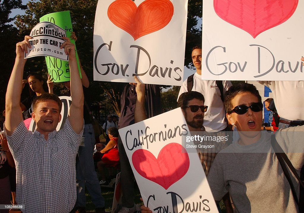Supporters and Tom McClintock and <a gi-track='captionPersonalityLinkClicked' href=/galleries/search?phrase=Gray+Davis&family=editorial&specificpeople=200688 ng-click='$event.stopPropagation()'>Gray Davis</a> clash outside the California Governor's Recall Debate.