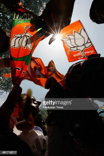BJP supporters and workers celebrate during the BJP parliament board meeting after party's landslide victory in Lok Sabha election at BJP Headquarter...