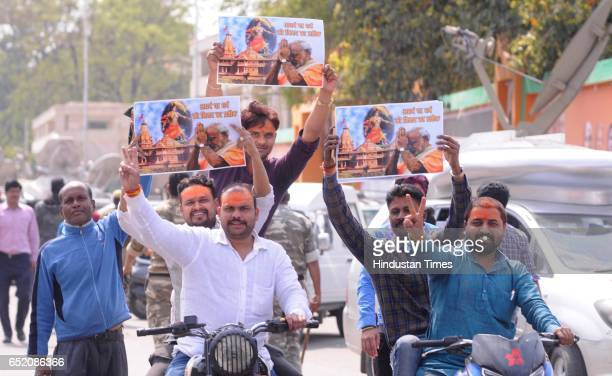 BJP supporters and workers celebrating after landslide victory in Uttar Pradesh and Uttarakhand assembly elections at BJP office on March 11 2017 in...