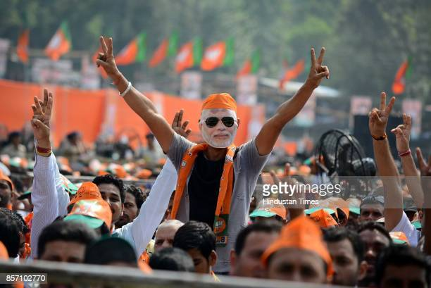 BJP supporters and workers during a BJP Abhar Rally of Prime Minister Narendra Modi at Luhnu ground on October 3 2017 in Bilaspur India PM Modi who...