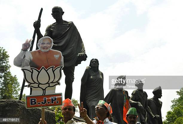 BJP supporters and workers waiting during the road show of BJP Prime Ministerial candidate Narendra Modi from airport to BJP headquarter after partys...