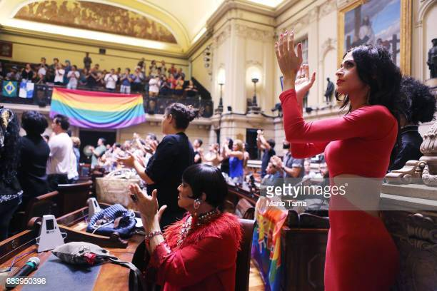 LGBT supporters applaud during a protest held inside city council on May 16 2017 in Rio de Janeiro Brazil Protestors occupied the chamber in a...