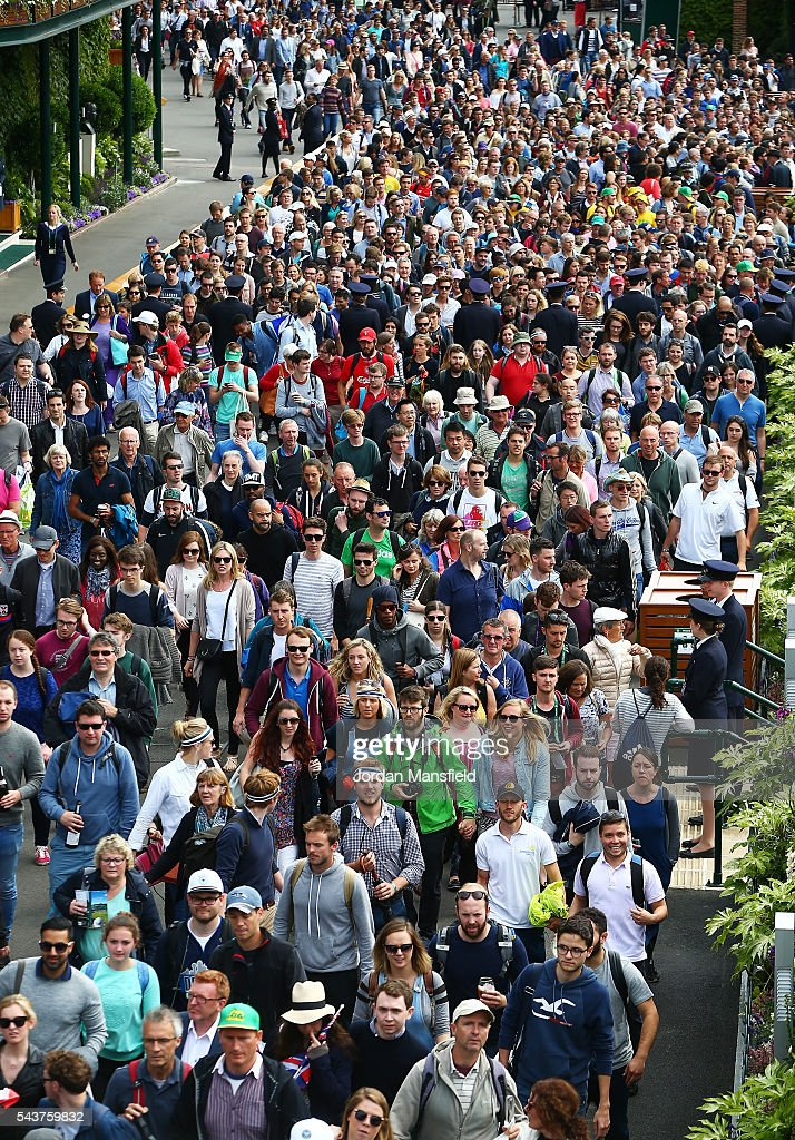 Supporters are held back as they wait to enter on day four of the Wimbledon Lawn Tennis Championships at the All England Lawn Tennis and Croquet Club on June 30, 2016 in London, England.