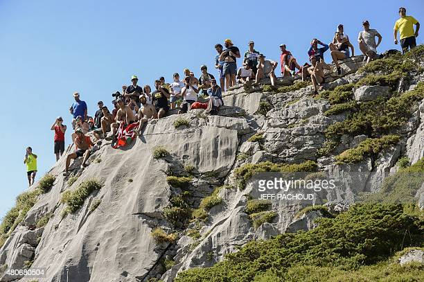Supporters are pictured during the 167 km tenth stage of the 102nd edition of the Tour de France cycling race on July 14 between Tarbes and La...